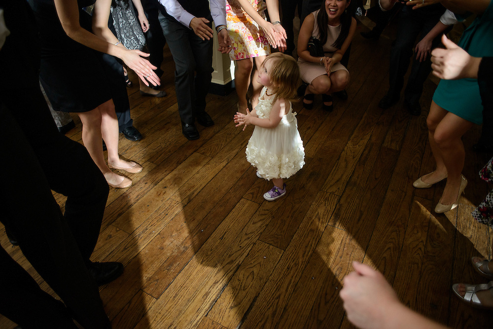 Photo by Matt Roth.Assignment ID: 30140754A..The flower girl finds herself in a dance circle during Evelyn Hsieh and Michael Wong's reception at the the Mount Vernon Inn, in Mount Vernon, Virginia on Saturday, April 06, 2013.