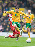 Norwich City - Saturday May 8 2010: Wes Hoolahan of Norwich City gets a bad tackle from Carlisle player during match at Carrow Road, Norwich. (Pic by Rob Colman Focus Images)