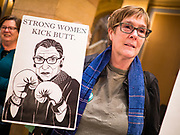 05 MARCH 2020 - ST. PAUL, MINNESOTA: PAT MOORE, from Stillwater, MN, carries a sign supporting US Supreme Court Justice Ruth Bader Ginsberg during a rally in support of the ERA in the rotunda at the Minnesota State Capitol. About 75 people, mostly women, came to the capitol to support ratification of the Equal Rights Amendment and mark the local observance of International Women's Day. International Women's Day is celebrated on March 8 around the world.    PHOTO BY JACK KURTZ