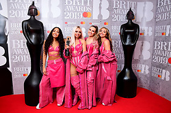 Leigh-Anne Pinnock, Jesy Nelson, Perrie Edwards and Jade Thirlwall of Little Mix with their Best British Video Brit Award in the press room at the Brit Awards 2019 at the O2 Arena, London.