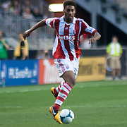 Stoke City F.C. Defender RYAN SHOTTON (30) dribbles the ball up field in the first half a MLS regular season international friendly match against the Philadelphia Union Tuesday, July. 30, 2013 at PPL Park in Chester PA.