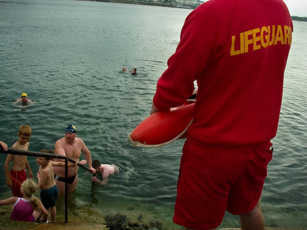 Lifeguard on duty after an open sea swim, Sandycove, Co. Dublin June 2005.
