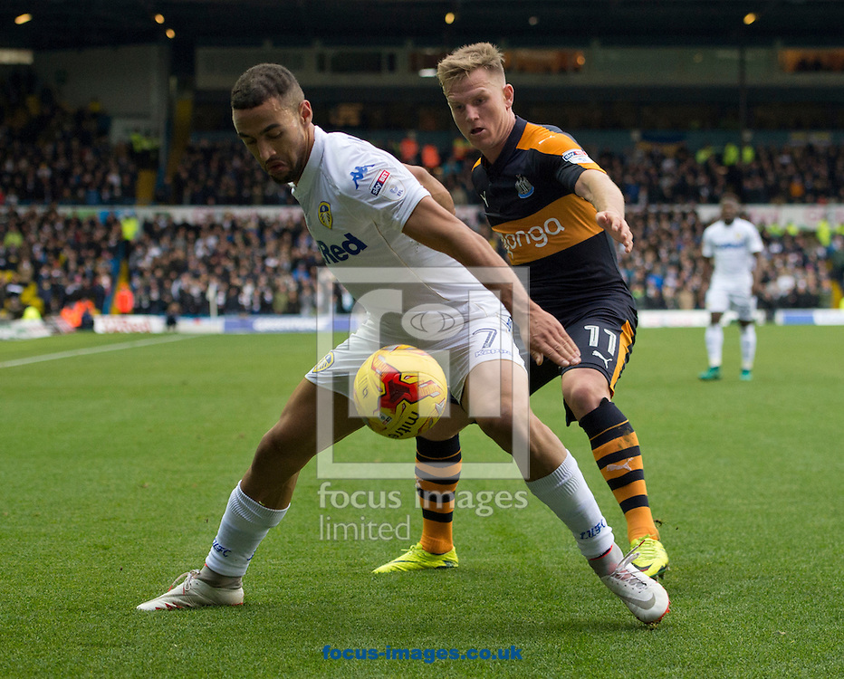 Kemar Roofe of Leeds United (nearest) shields the ball from Matt Ritchie of Newcastle United during the Sky Bet Championship match at Elland Road, Leeds<br /> Picture by Russell Hart/Focus Images Ltd 07791 688 420<br /> 20/11/2016