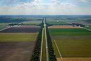 Nederland, Flevoland, Gemeente Zeewolde, 27-08-2013; Vogelweg in zuidwestelijke richting. Beplanting ontworpen door landschapsarchitect bij de inrichting van de polder,  dubbele rijen populieren.<br /> Vogelweg in the newe polder Flevoland. Planting designed by landscape architect for the design of the polder, double rows of poplars.<br /> aerial photo (additional fee required);<br /> copyright foto/photo Siebe Swart.