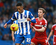 Brighton striker Rajiv van La Parra shields the ball from Middlesbrough FC midfielder Grant Leadbitter during the Sky Bet Championship match between Brighton and Hove Albion and Middlesbrough at the American Express Community Stadium, Brighton and Hove, England on 19 December 2015. Photo by Bennett Dean.