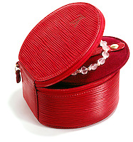 Louis Vuitton red jewelry box on white background