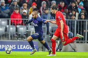 Tottenham Hotspur midfielder Lucas Moura (27) goes past Bayern Munich defender Javi Martínez (8) during the Champions League match between Bayern Munich and Tottenham Hotspur at Allianz Arena, Munich, Germany on 11 December 2019.