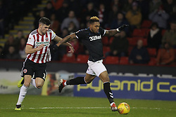 February 13, 2019 - Sheffield, South Yorkshire, United Kingdom - SHEFFIELD, UK 13TH FEBRUARY Britt Assombalonga of Middlesbrough and John Egan of Sheffield United  during the Sky Bet Championship match between Sheffield United and Middlesbrough at Bramall Lane, Sheffield on Wednesday 13th February 2019. (Credit: Mark Fletcher | MI News) (Credit Image: © Mi News/NurPhoto via ZUMA Press)