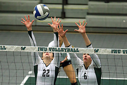 28 October 2016:  Anne Cummings and Maisy Bowden during an NCAA womens division 3 Volleyball match between the DePauw Tigers and the Illinois Wesleyan Titans in Shirk Center, Bloomington IL
