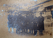 silver mirroring vintage group portrait with businessmen Japan