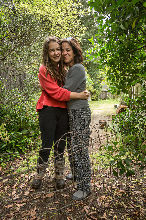 Kim Wedlake and her daughter, Sofia, hug outside their home on Easter morning in Calistoga.