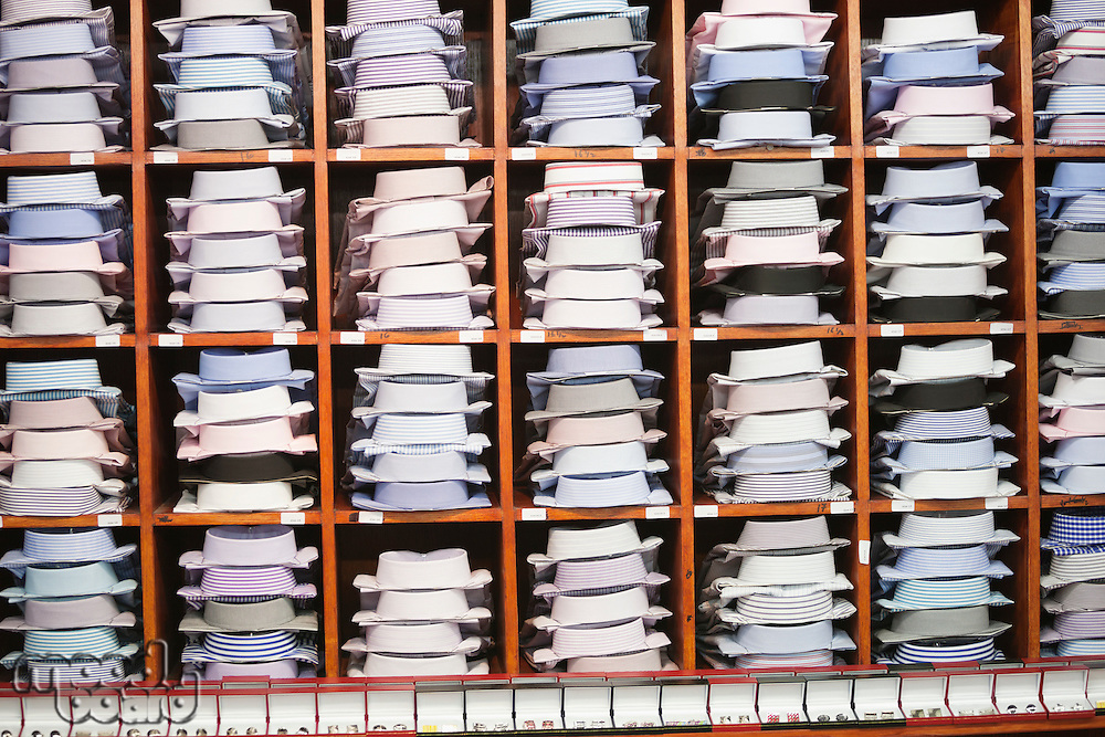 Shirts and hand cuff links displayed on shelves