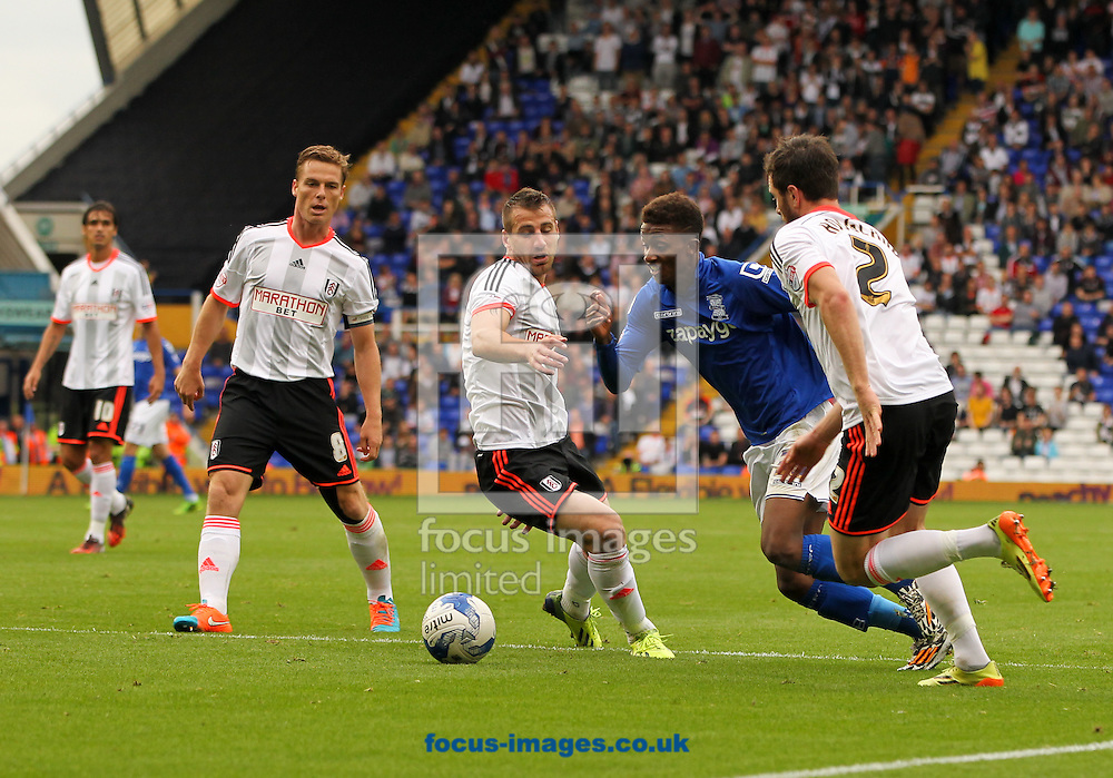 Demarai Gray (2nd right) of Birmingham City attempts to run through the Fulham defence during the Sky Bet Championship match at St Andrews, Birmingham<br /> Picture by Tom Smith/Focus Images Ltd 07545141164<br /> 27/09/2014