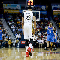 Jan 25, 2017; New Orleans, LA, USA; New Orleans Pelicans forward Anthony Davis (23) holds his right leg as he leaves the court during the second quarter of a game against the Oklahoma City Thunder at the Smoothie King Center. Mandatory Credit: Derick E. Hingle-USA TODAY Sports
