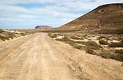 Unmade road passing Agujas Grandes volcano, La Isla Graciosa, Lanzarote, Canary Islands, Spain