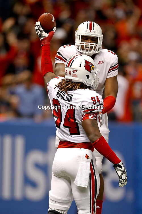 Jan 2, 2013; New Orleans, LA, USA; Louisville Cardinals defensive end Lorenzo Mauldin (94) celebrates with cornerback Jordon Paschal (22) after recovering a fumble during the third quarter of the Sugar Bowl against the Florida Gators at the Mercedes-Benz Superdome.  Mandatory Credit: Derick E. Hingle-USA TODAY Sports