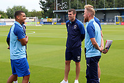 AFC Wimbledon striker Kweshi Appiah (9), AFC Wimbledon midfielder Mitchell (Mitch) Pinnock (11) and AFC Wimbledon attacker Adam Roscrow prior to kick off AFC Wimbledon midfielder Scott Wagstaff (7) during the Pre-Season Friendly match between AFC Wimbledon and Brentford at the Cherry Red Records Stadium, Kingston, England on 5 July 2019.