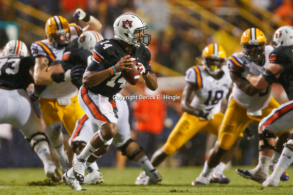 Sep 21, 2013; Baton Rouge, LA, USA; Auburn Tigers quarterback Nick Marshall (14) scrambles against the LSU Tigers during the second quarter of a game at Tiger Stadium. Mandatory Credit: Derick E. Hingle-USA TODAY Sports