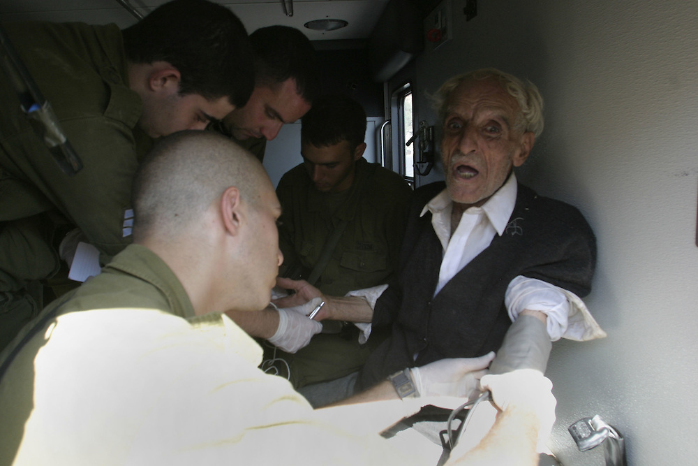 .. Lebanese Prisoner  of war Roslan Abou Taleb  72 that be caught by the Israeli during an operation in Lebanon, get treatment by an Israeli army forces doctor before they release  back to Lebanon...At the Rosh Hanikrah check point on the border with Lebanon at 11 August 2006..