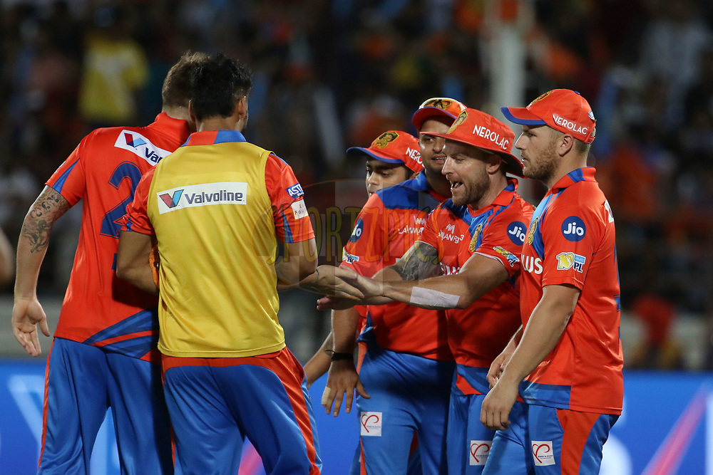 Gujarat Lions players celebrates the wicket of Kieron Pollard of the Mumbai Indians during match 35 of the Vivo 2017 Indian Premier League between the Gujarat Lions and the Mumbai Indians  held at the Saurashtra Cricket Association Stadium in Rajkot, India on the 29th April 2017<br /> <br /> Photo by Vipin Pawar - Sportzpics - IPL