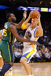 Feb 2, 2012; Oakland, CA, USA; Golden State Warriors center Andris Biedrins (15) is defended by Utah Jazz center Al Jefferson (25) during the first quarter at Oracle Arena. Golden State defeated Utah 119-101. Mandatory Credit: Jason O. Watson-US PRESSWIRE