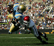 UCLA's Maurice Drew dives for a touchdown in front of Oklahoma's Darien Williams in the fourth quarter of the Bruins' 41-24 victory at the Rose Bowl in Pasadena Saturday September 17, 2005.