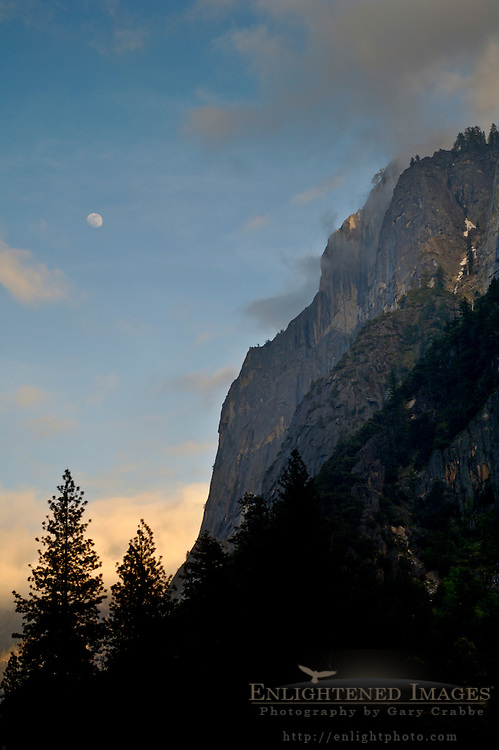 Moonrise and clouds at sunset next to Glacier Point, above Yosemite Valley, Yosemite National Park, Callifornia