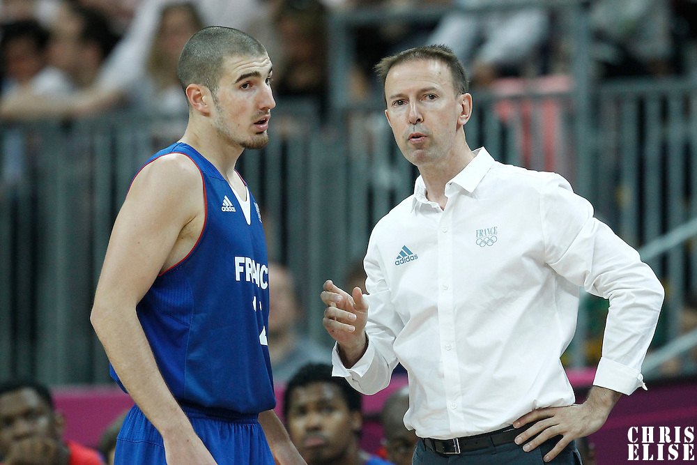 29 July 2012: France head coach Vincent Collet talks to Nando De Colo during the 98-71 Team USA victory over Team France, during the men's basketball preliminary, at the Basketball Arena, in London, Great Britain.