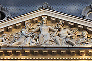 Pediment, 1911, by Jean Luc, with allegorical figures of City, with River and Mercury, capping the main entrance to the registered head office of Societe Generale, at 29 Boulevard Haussmann in the 9th arrondissement of Paris, France. The building was originally built 1867-71 by Charles Rohault de Fleury as apartments, then transformed 1906-12 by Jacques Hermant, and in use from 1915. Societe Generale, founded 1864, remains one of the largest banks in the world, although its headquarters are now at La Defense. The Haussmann building is listed as a historic monument. Picture by Manuel Cohen