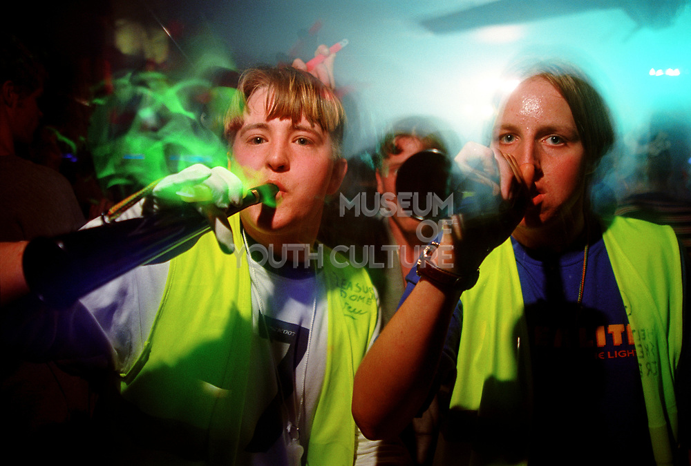 Two girls blowing horns, 12/4/1997, Pleasure Dome, Skegness.