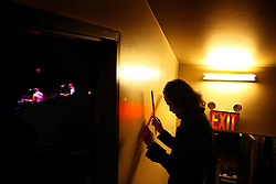 The post-punk band The Killers perform at the Hammerstein Ballroom at Manhattan Center Studios in New York, N.Y. on Oct. 24, 2008. Drummer Ronnie Vannucci Jr. warms up backstage while opening act The Envy Corps perform onstage.