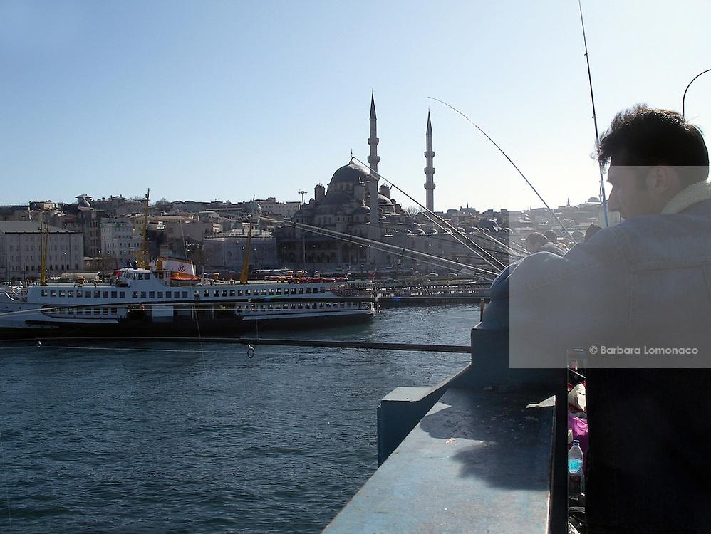 Istanbul. Men fishing from the Galata bridge.