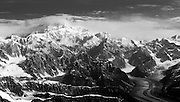 Aerial view of Denali (Mt. McKinley), the Tokositna Glacier (right), the Kahiltna Glacier (left) and the Alaska Range on a sightseeing flight from Talkeetna, Alaska.