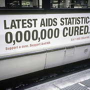 AIDS bus poster  ?Latest AIDS Statistic 0.000,000 Cured?, AIDS awarness. Support a cure