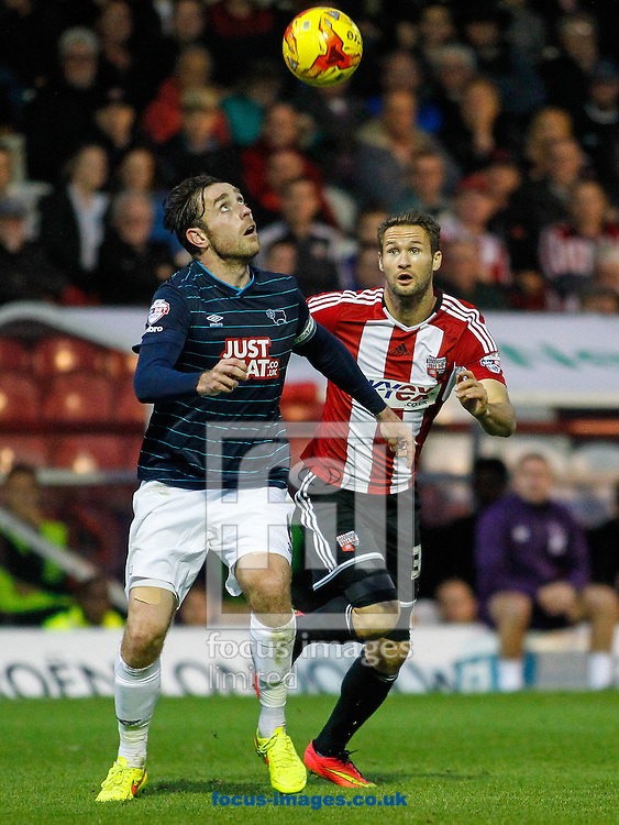 Richard Keogh of Derby County and Nick Proschwitz of Brentford during the Sky Bet Championship match between Brentford and Derby County at Griffin Park, London<br /> Picture by Mark D Fuller/Focus Images Ltd +44 7774 216216<br /> 01/11/2014