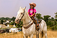 Crow Fair, granddaughter of Henry Real Bird, riding horse, Crow Indian Reservation, Montana