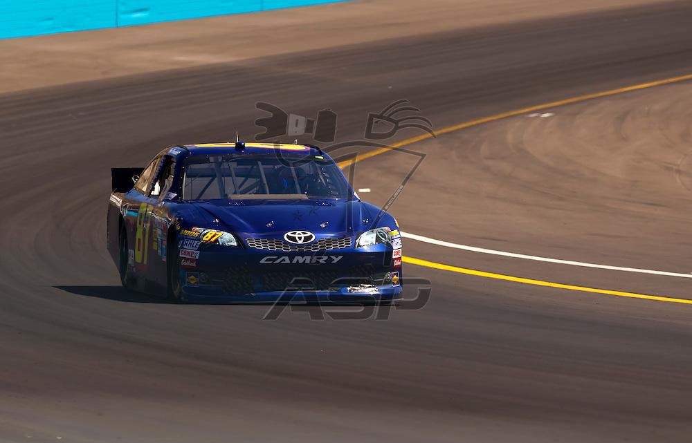 AVONDALE, AZ - MAR 03, 2012:  Joe Nemechek (87) brings his NASCAR Sprint Cup car through turn 4 during qualifying for the Subway Fresh Fit 500 race at the Phoenix International Raceway in Avondale, AZ.