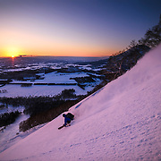 Jake Cohn shreds Shiribetsu-dake at sunset, Rusutsu, Japan.