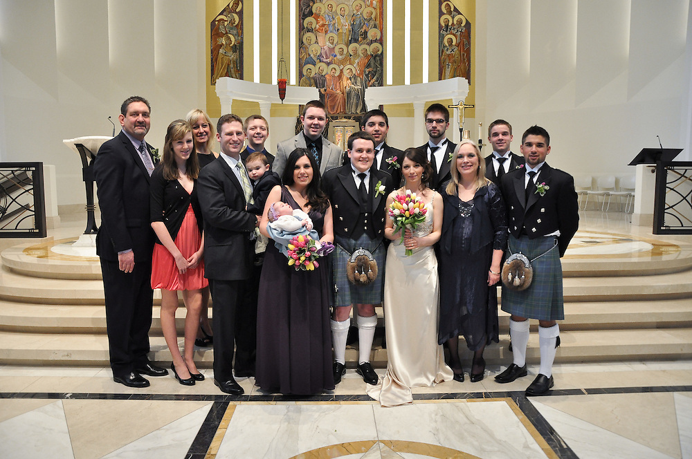 Kathleen's Family, Kathleen & Brendan kneel before the altar, Madonna della Strada Chapel, Loyola University Chicago
