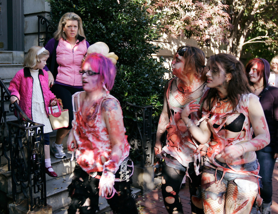 -October 25, Boston, MA-..As bystanders stop and stare, Kelsey Marr, left, 19, of Jamaica Plain, MA, Alexis Lopez, center, 17, of Watertown, MA, and Sophia Goutzinos, right, 19, of Boston take part in the Zombie March through Boston on Sunday afternoon...(Photo by Brooks Canaday)