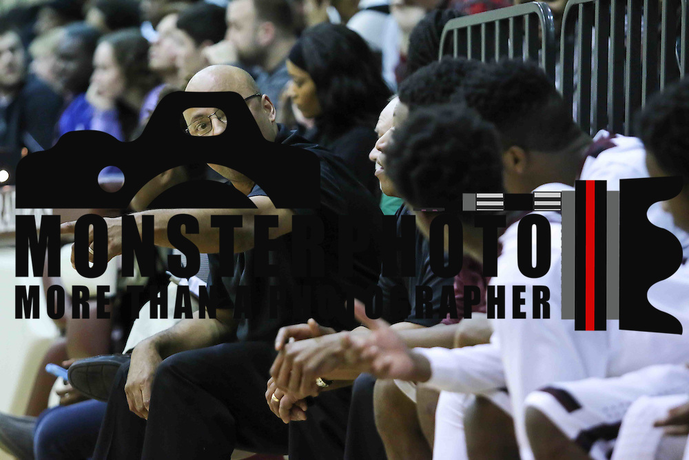 Concord Raiders Head Coach Ralph Flowers coaches his players on the bench in the second half of a regular season non-conference high school basketball game between the Plymouth Whitemarsh Colonials and Concord High Raiders Monday, Jan. 19, 2015 at Concord High School in Wilmington, DEL