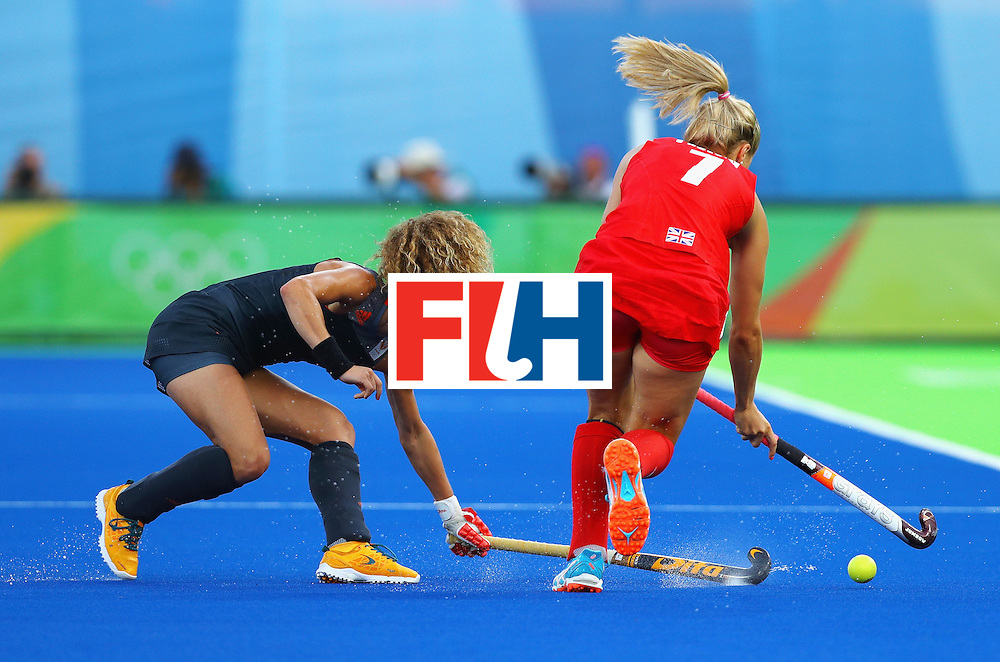 RIO DE JANEIRO, BRAZIL - AUGUST 19:  Maria Verschoor of Netherlands tackles Georgie Twigg of Great Britain on Day 14 of the Rio 2016 Olympic Games at the Olympic Hockey Centre on August 19, 2016 in Rio de Janeiro, Brazil.  (Photo by Tom Pennington/Getty Images)