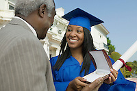 Father Giving Daughter Graduation Gift