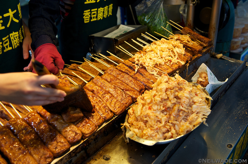 This famous stinky tofu stall in Shenkeng, Taiwan, had a long line of people waiting to buy the odd food.