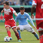 Kelyn Rowe, (left), New England Revolution, is challanged by Diego Martínez, NYCFC, during the New York City FC Vs New England Revolution, MSL regular season football match at Yankee Stadium, The Bronx, New York,  USA. 26th March 2016. Photo Tim Clayton