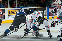 KELOWNA, CANADA - APRIL 17: Cole Linaker #26 of Kelowna Rockets digs for the puck after the face off against Logan Fisher #20 of Victoria Royals on April 17, 2016 at Prospera Place in Kelowna, British Columbia, Canada.  (Photo by Marissa Baecker/Shoot the Breeze)  *** Local Caption *** Logan Fisher; Cole Linaker;