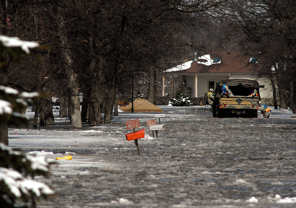 The National Guard makes its way around Oakport Township in Moorhead, Minn. patrolling the community for anyone in need.