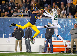 Oct 25, 2018; Morgantown, WV, USA; West Virginia Mountaineers wide receiver David Sills V (13) catches a pass while defended by Baylor Bears defensive back Kalon Barnes (27) during the second quarter at Mountaineer Field at Milan Puskar Stadium. Mandatory Credit: Ben Queen-USA TODAY Sports