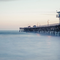 San Clemente pier at dusk panorama photo. San Clemente California is a popular coastal beach city along the Pacific Ocean n the United States of America. Panoramic photo ratio is 1:3. Copyright ⓒ 2017 Paul Velgos with All Rights Reserved.