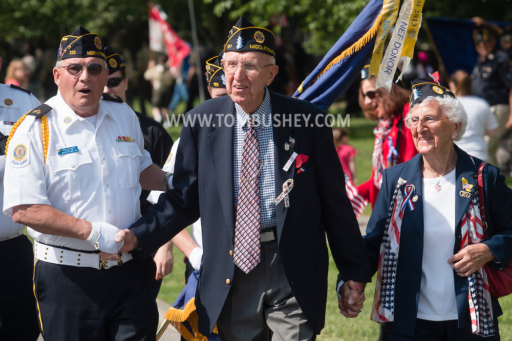 Middletown, New York - Grand Marshall Edward Collins, center,  walks to the car he will be riding in before the start of teh Middletown-Town of Wallkill Memorial Day parade at Thrall Park on  May 25, 2015.